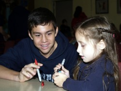 Angelo helps Calista create a Guatemalan worry doll